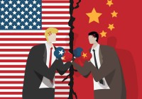 two business people wearing boxing gloves for fight , flag of USA and China at background. trade war between USA and China concept